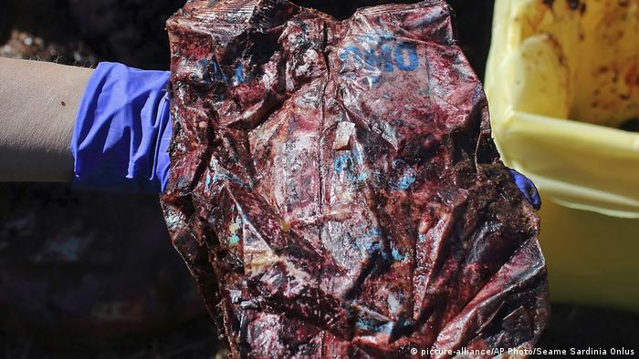 Some of the bloody plastic found in its belly of a sperm whale found dead off Sardinia in 2019