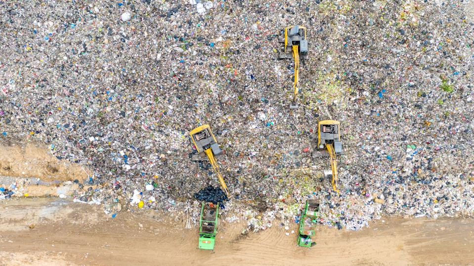 Aerial shot top view Garbage trucks unload garbage to a recycle in the vicinity of the city of Bangkok, Thailand