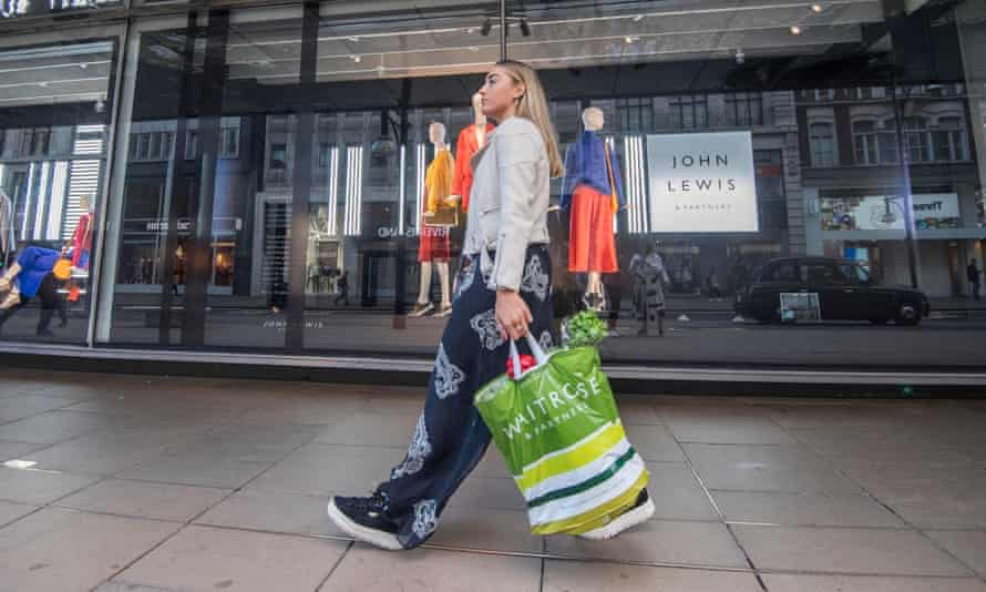 Woman carrying Waitrose 'bag for life'